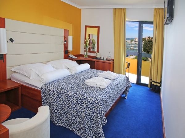 double room premium sea side with balcony and half board