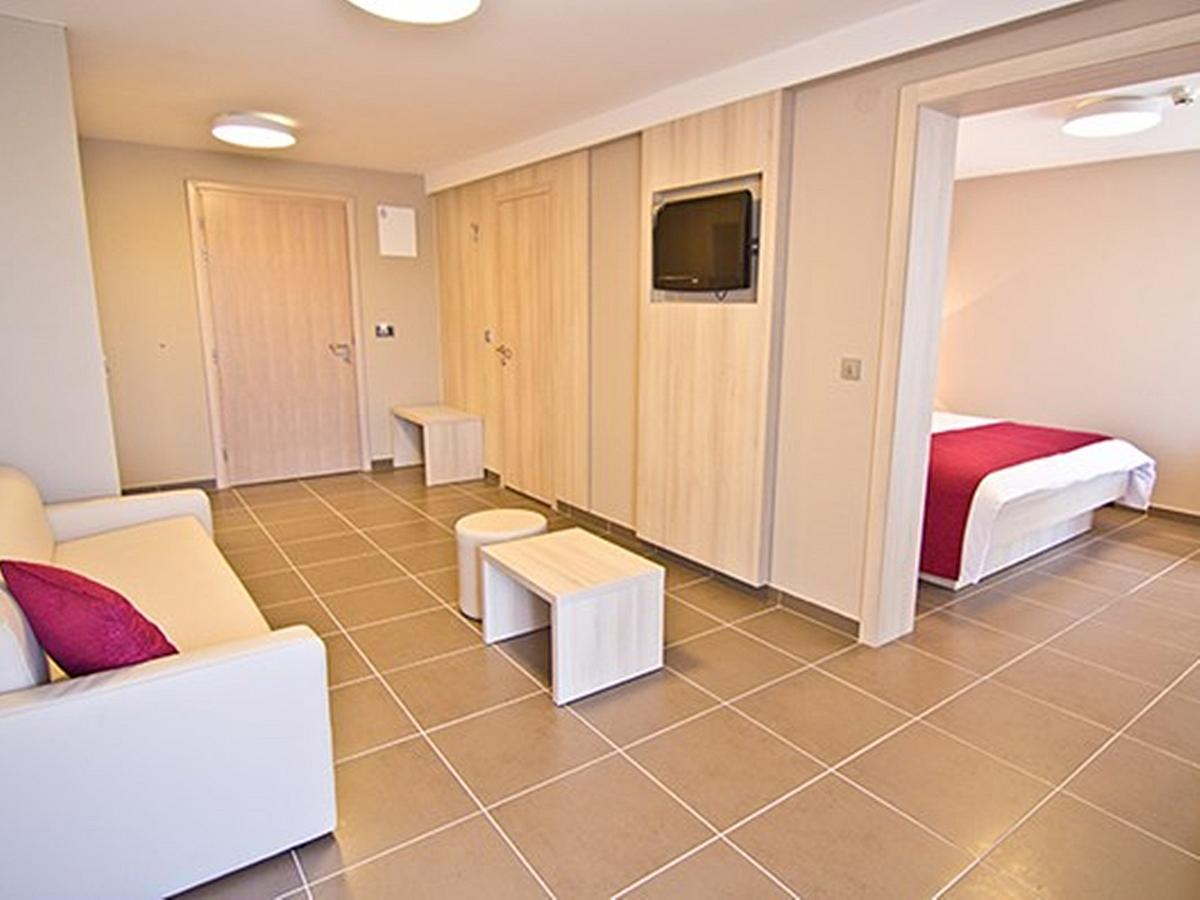 Double room suite, junior with 3 help beds with balcony and half board