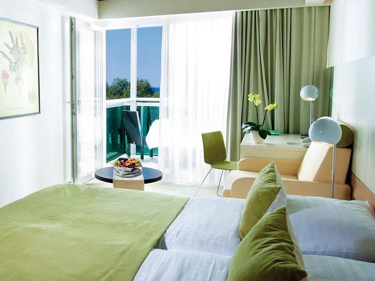 Two double rooms with connecting door with extra bed on sea side with balcony and half board