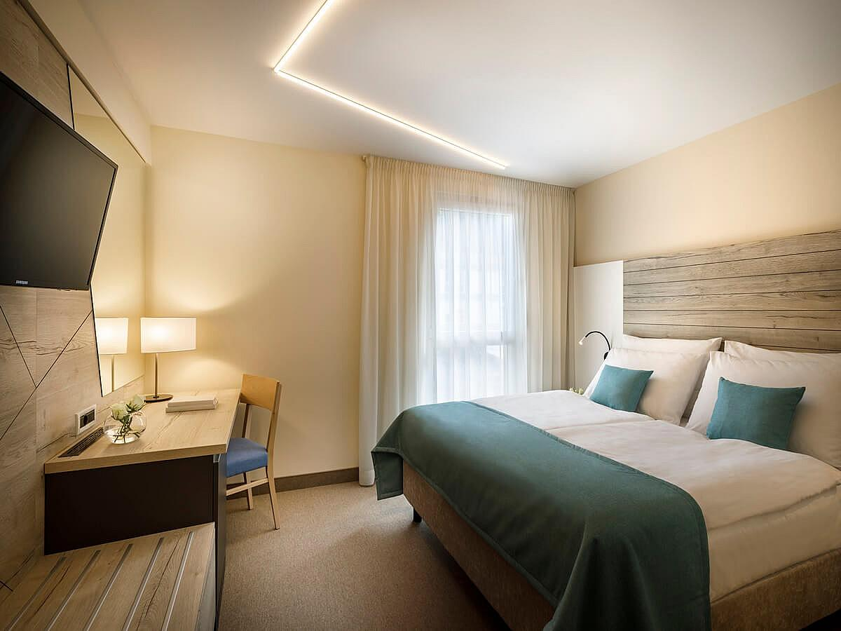 Single room, standard atrium view with half board