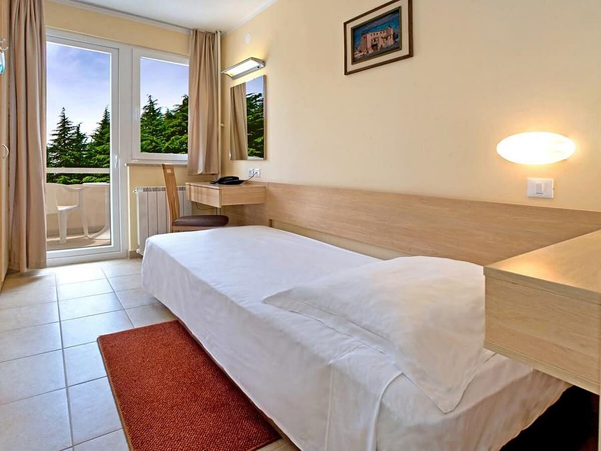 Single room classic with balcony and half board