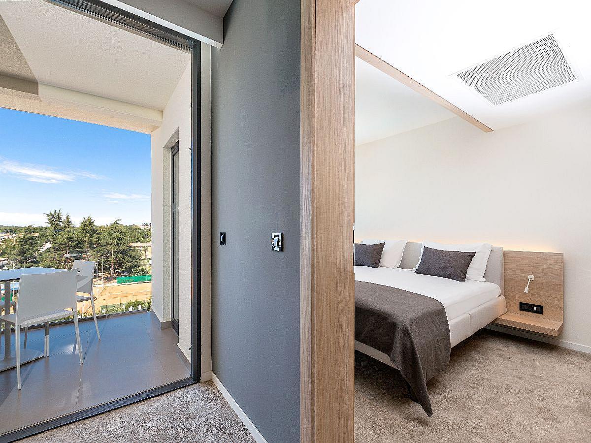 Dvoulůžkový pokoj s balkónem  se 2 pomocnými lůžky - polopenzí