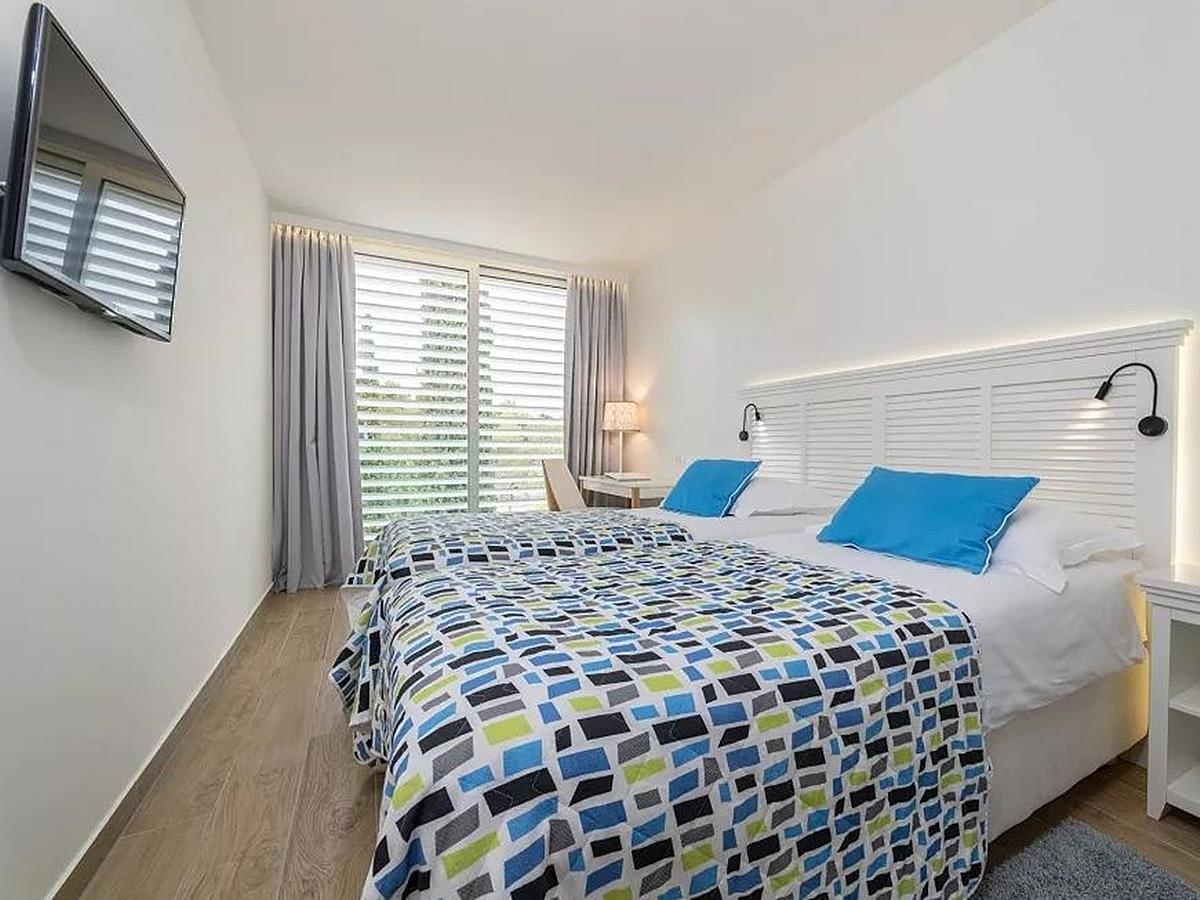 Two double next door rooms with French balcony with courtyard or garden viewwirh bed and breakfast service
