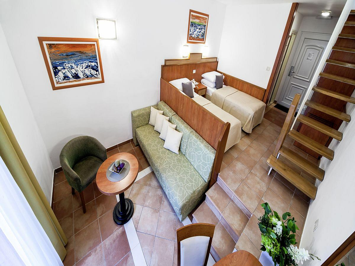 Double room family + 3 help beds, with balcony and half board