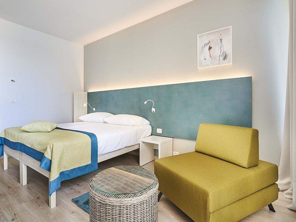 Doppelzimmer mit 2 Zusatzbetten und Balkon- Familienzimmer mit HP