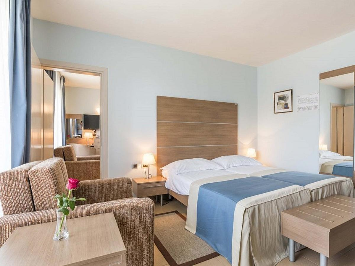 Two double classic rooms, only one with one help bed, park side with balcony and connecting door - half board