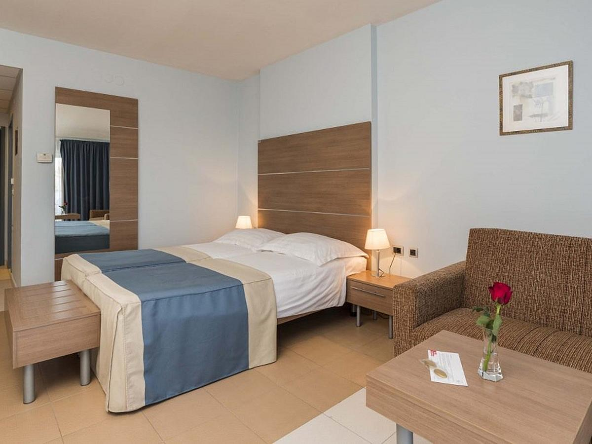 Two double premium rooms each with one extra bed, pool side with balcony and connecting door - half board