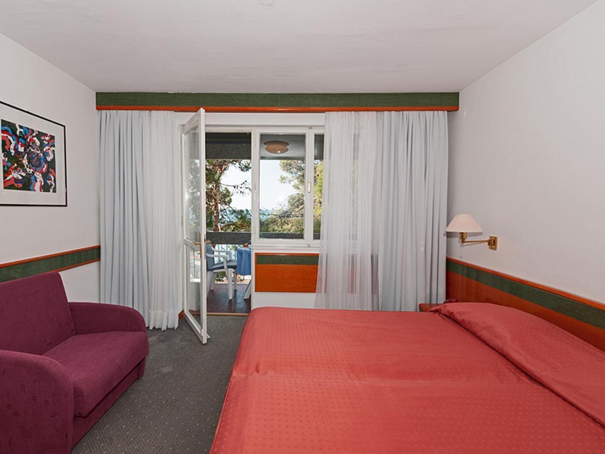 Dvoulůžkový pokoj, premium, s přídavným lůžkem, strana k moři s balkónem, nocleh - snídaně